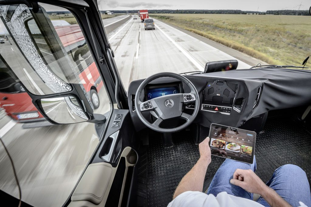 Driver relaxes in a Self-driving Truck or the Future Truck 2025 (Image courtesy- Daimler AG)